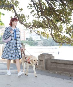 Picture shows Ingrid, a Guide Dog Handler, walking with her Guide Dog